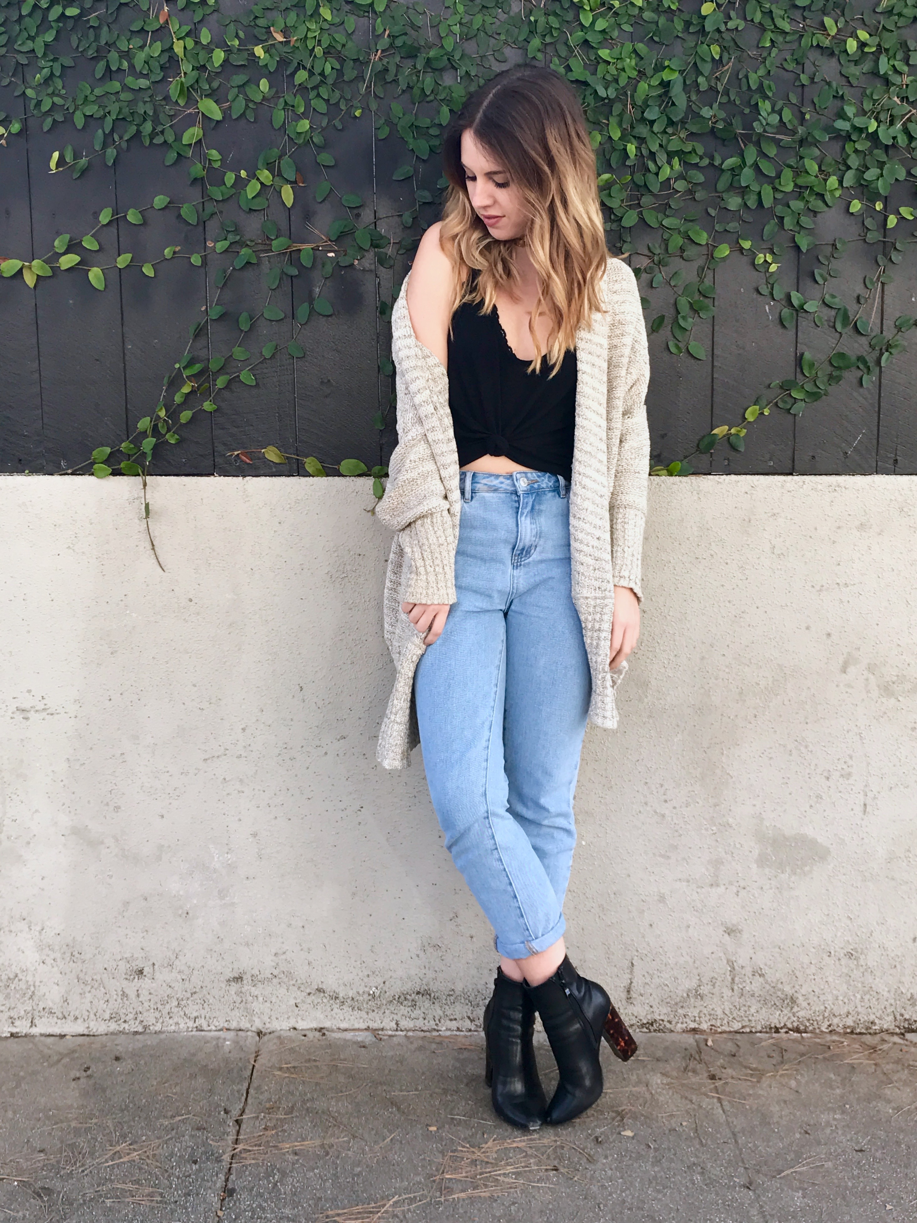 While the mom jean is extremely wearable, there are a few ways I personally  love to style them. I wear them with cozy sweaters as well as bodysuits,